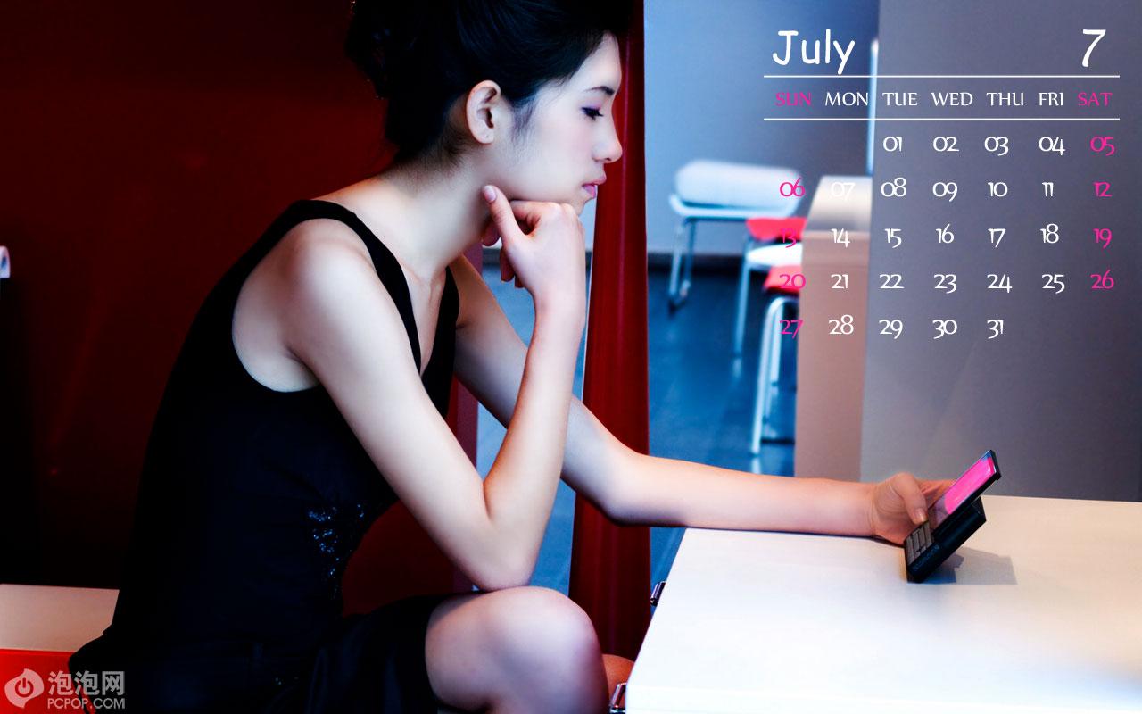 美女+靓机!oqo精美2008年历壁纸下载